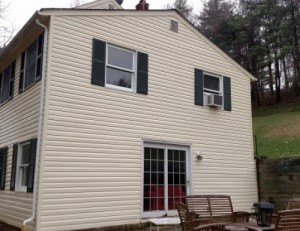 After photo vinyl siding house soft wash power wash in Woodbine 21797